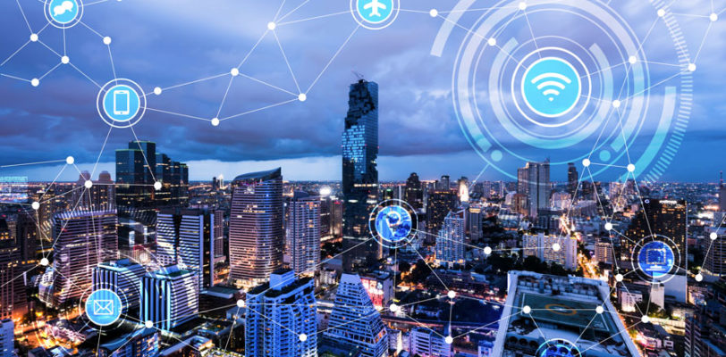 city scape with dark blue sky and smart grid symbols
