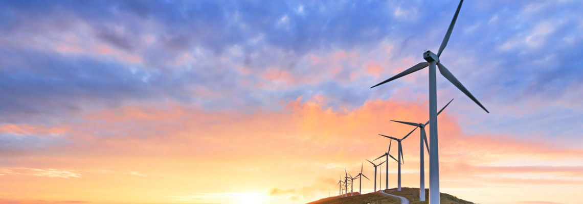 clean energy pink and blue sky with wind turbines
