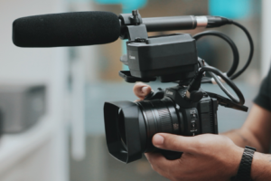man-holding-video-camera